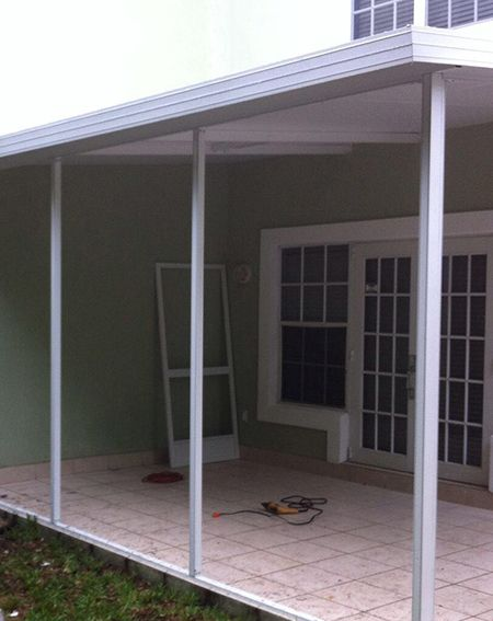 Screen patio with roof installation in Cayman Islands